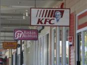 Picture of signs on Kentucky Fried Chicken and Baskin 31 Robins.