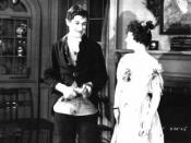 Will Rogers as Ichabod Crane and Lois Meredith as Katrina Van Tassel, in the feature The Headless Horseman (1922)