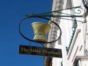 English: Pharmacy sign - Cheap Street This is the trade sign for The Abbey Pharmacy. The pestle and mortar were the essential items of equipment for the traditional pharmacist. Virtually anything could be ground up and put into all types of medication be