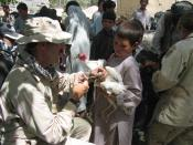 Provincial Reconstruction Team veterinarian vaccinates a chicken. Keywords: Afghanistan Farm Animals Chickens Veterinary Livestock Children Boys.