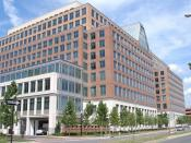 English: The south side of the James Madison Building in Alexandria, Virginia. It is one of the five buildings that forms the headquarters of the United States Patent and Trademark Office. All the top PTO officials have offices in this building.