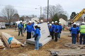 English: VIRGINIA BEACH, Va. (Feb. 2, 2011) Sailors assigned to the aircraft carrier USS Theodore Roosevelt (CVN 71) help build a home for a mother currently raising six foster children. The project is part of an episode of Extreme Home Makeover: Home Edi