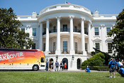 First Lady Michelle Obama participates in the filming of an episode of Extreme Makeover: Home Edition on the South Lawn of the White House, July 27, 2011. (Official White House Photo by Samantha Appleton)