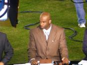 English: Deion Sanders as an analyst for the NFL Network, 2008. Photo courtesy of Michael De Jesus, via Flickr. License has since been changed, but was under CC-BY when uploaded.