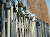 English: Unusual Decorations Blaby Seen arrayed along the security fence of a telecoms mast between Westfield park and the Lions rugby ground. A quiet place for illicit underage drinking (not proved) Carling, Carlsberg and Bulmers are all represented in t