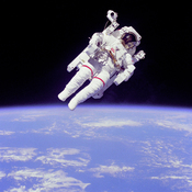English: Mission: STS-41-B Film Type: 70mm Title: Views of the extravehicular activity during STS 41-B Astronaut Bruce McCandless II, mission specialist, participates in a extra-vehicular activity (EVA), a few meters away from the cabin of the shuttle Cha