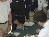 "Denver, CO, May 21, 2004 -- Homeland Security Under Secretary and director of FEMA Michael D. Brown signs books for firefighters. Brown was in Golden for the national roll-out of FEMA's fire book ""At Home In The Woods, lessons learned in the wildland"