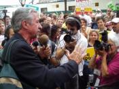 English: Photo of Tom Hayden addressing an anti-war demonstration in Boston during the 2004 Democratic National Convention by Brian Corr, July 29, 2004. Released under GNU Free Documentation License