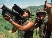English: A US Marine with a field radio relays the direction of aircraft approaching the Crow Valley Electronic Warfare Tactical Range to the operator of an FIM-92 Stinger missile launcher during Exercise COPE THUNDER '84-7.