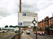 English: I took this picture of a Welsh language (y Gymraeg) road sign near Wrexham Central station my self in the year 2009. I here by release it in to the public domain.