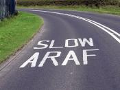 Welsh road markings seen near Cardiff Airport, Wales.