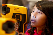 English: RIVERSIDE, Calif. (Oct. 13, 2010) A fourth grade student from Arlanza Elementary School looks through a Navy thermal imager during the 11th annual Science and Technology Education Partnership (STEP) Conference. The event, sponsored by the Naval S