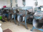 English: A little mill in Oaxaca, where people can have roasted cocoa beans and spices ground up for chocolate, or roasted chilies ground up for Mole.