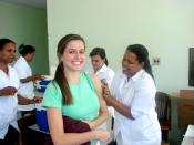 English: Woman receiving rubella vaccination, School of Public Health of the State of Minas Gerais (ESP-MG), Brazil