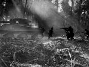 U.S. Army soldiers on Bougainville (one of the Solomon Islands) in World War II. Japanese forces tried infiltrating the U.S. lines at night; at dawn, the U.S. soldiers would clear them out. In this picture, infantrymen are advancing in the cover of an M4