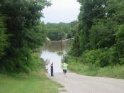 English: Some residents of rural Grayson County, TX. discover that the way home is blocked by flood waters.