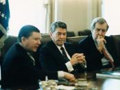 English: President Ronald Reagan receives the Tower Commission Report regarding the Iran-Contra affair in the Cabinet Room with John Tower and Edmund Muskie.