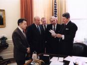 President Ronald Reagan with Caspar Weinberger, George Shultz, Ed Meese, and Don Regan discussing the President's remarks on the Iran-Contra affair, Oval Office