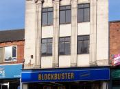 English: Blockbuster Video Shop This building, now home to Blockbuster Video, looks like it might have started life as a small department store.
