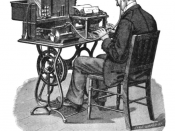 A 'G' (Graham Bell) model Graphophone being played by a typist after it had recorded dictation.