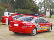 English: Three Australian Federal Police, Ford BF Falcon MkII XT, cars.