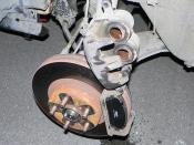 English: Twin-pot disc brake calliper(Twin-pot front disc brake calliper from a JDM 1996 Subaru Legacy GT)