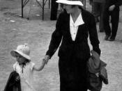 English: Mother and child at the show, 1938. Both mother and toddler daughter wear bonnets and carry coats.