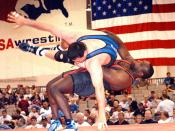 Byers determined to wrestle another Olympics before coaching 110215