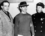 English: Carl Cintron flanked by Transit Patrolman Ernest Fatoruso, and Patrolman Frank Collins of Safety Unit E at Poplar St. police station Brooklyn.