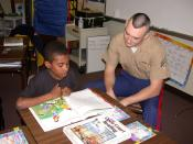 English: Park Street Elementary School, Atlanta, Ga. (Dec. 11, 2002) -- A U.S. Marine helps a student with reading comprehension as part of a Partnership in Education program sponsored by Park Street Elementary School and Navy /Marine Corps Reserve Center