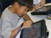 Avery Coonley School student with tablet computer.