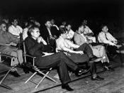 A group of physicists at a 1946 Los Alamos colloquium. In the front row are Norris Bradbury, John Manley, Enrico Fermi and J.M.B. Kellogg (L-R). Oppenheimer is in the second row on the left; to the right in the photograph is Richard Feynman.