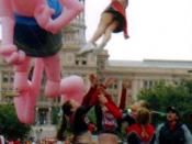 A cheerleading stunt during a parade in Austin Texas.