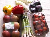 English: A picture of a collection of healthy (low-calorie) snacks. These include (from left to right): paprika, endives, beetroots, apples, asperges, and cherry tomatoes