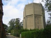English: Hemel Hempstead: High Street Green Water Tower Hexagonal in plan, this water tower is actually on Farmhouse Lane off High Street Green, and has the usual array of mobile telephone antennae festooned along its parapet.