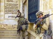 English: US Marines Corps (USMC) Marines from the 1st Battalion, 7th Marines (1/7), Charlie Company, Twentynine Palms, California (CA), cover each other with 5.56 mm M16A2 assault rifles as they prepare to enter one of Saddam Husseins palaces in as they t