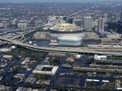 Excerpt from US Navy photo http://www.navy.mil/view_single.asp?id=27553, an aerial view from a United States Navy helicopter showing floodwaters around the entire downtown New Orleans area. The Louisiana Superdome is in the center.