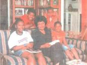 scan of poster featuring the Florida Academy of African-American Culture that was founded by Ruby Woodson in Sarasota, Florida - she is seen seated with children visiting its African-American Culture Research Center and Library