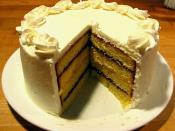 English: A layered pound cake, with alternating interstitial spaces filled with raspberry jam and lemon curd, finished with buttercream frosting.