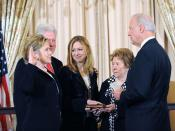 English: Secretary of State Hillary Clinton ceremonially sworn in by Vice President Biden with former President Clinton, their daughter Chelsea, and her mother Dorothy at her side.