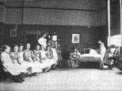 1898 photograph of a group of young girls learning how to make a bed at a
