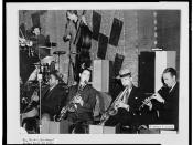[Portrait of Ray Bauduc, Herschel Evans, Bob Haggart, Eddie Miller, Lester Young, and Matty Matlock, Howard Theater, Washington, D.C., ca. 1941] (LOC)