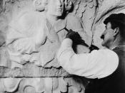 English: Cathedral of St. John the Divine — A stone sculptor working on a capital with an angel