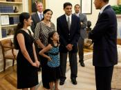 English: President Barack Obama greets Kavya Shivashankar, left, the 2009 Scripps Spelling Bee winner, and her family in the Oval Office, June 3, 2010.