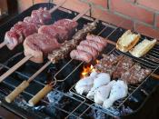 Photo of a Churrasco (brazilian barbecue), as prepared by cariocas. Left to right and down are Fraldinha, Picanha, Coração (chicken heart), lingüiça (sausages), garlic bread, sliced picanha with garlic and chicken legs.