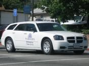 English: A Dodge Magnum in the livery of Farmers Insurance, in Fillmore.