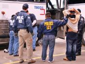 English: ICE Special Agents (U.S. Immigration and Customs Enforcement) arresting suspects during a raid
