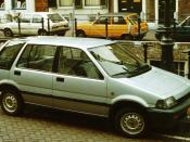 Honda Civic Shuttle by a city center canal 1984