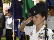 English: Battalion Commander Cadet Ensign Melanie Leonard, Radford High School Junior ROTC (Reserve Officers Training Corps), salutes during the parading of the colors ceremony held at the Parchee Memorial Submarine Base at this year's Memorial Day Ceremo