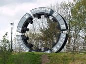 English: Miners wheel. Evans & Bevan, former Welsh Anthracite (coal) mine owners, major employers in the South Wales valleys. Immortalised in this sculpture on the old rail bed at Maesycwmmer. Ocean Coal and Empire Coal, were also large mining companies o